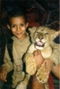 My son with a lion cub