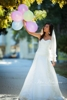 a little bride with baloons